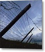 The Remains Of A Barbed Wire Fence That Metal Print by Steve Raymer