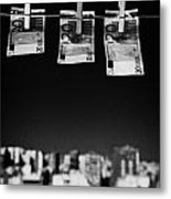 Three Twenty Euro Banknotes Hanging On A Washing Line With Blue Sky Over City Skyline Metal Print by Joe Fox