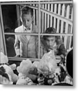 Toys In Window Metal Print by Orlando