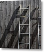 Two Ladders Leaning Against A Wooden Wall Metal Print by Meera Lee Sethi
