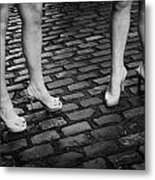 Two Young Women Wearing High Heeled Shoes And Fake Tan On Cobblestones On A Night Out In Dublin  Metal Print by Joe Fox
