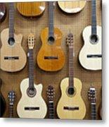 Various Guitars Hanging From Wall Metal Print by Lisa Romerein