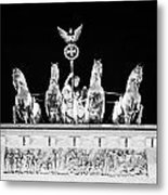 viktoria with quadriga on top of the Brandenburg gate at night Berlin Germany Metal Print by Joe Fox
