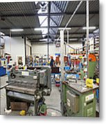 Workshop Full Of Machinery In A Factory Metal Print by Corepics
