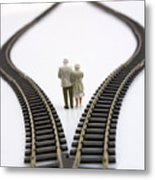 Figurines Between Two Tracks Leading Into Different Directions Symbolic Image For Making Decisions. Metal Print by Bernard Jaubert