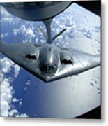 A B-2 Spirit Moves Into Position Metal Print by Stocktrek Images