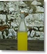 A Bottle Of Limoncello Sits On A Picnic Metal Print by Todd Gipstein