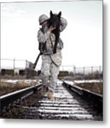A Military Dog Handler Uses An Metal Print by Stocktrek Images