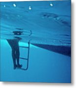 Bare Legs Descending Underwater From The Ladder Of A Boat Metal Print by Sami Sarkis