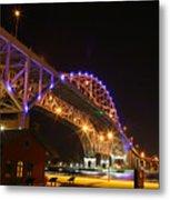 Blue Water Bridge At Night Metal Print by Paul Bartoszek