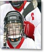 Boys Playing Ice Hockey Metal Print by Ria Novosti