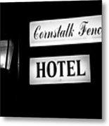 Cornstalk Fence Hotel Metal Print by Leslie Leda