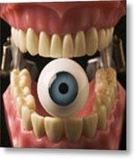 Eye Held By Teeth Metal Print by Garry Gay
