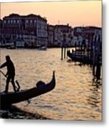 Gondolier In Venice In Silhouette Metal Print by Michael Henderson