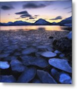 Ice Flakes Drifting Against The Sunset Metal Print by Arild Heitmann