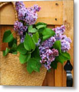 Lilacs In A Straw Purse Metal Print by Sandra Cunningham