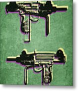 Mini Uzi Sub Machine Gun On Green Metal Print by Michael Tompsett
