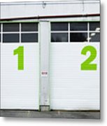 Numbers On Repair Shop Bay Doors Metal Print by Don Mason