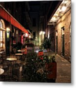 Pirates Alley At Night Metal Print by John Rizzuto