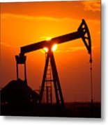 Pumping Oil Rig At Sunset Metal Print by Connie Cooper-Edwards