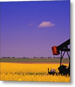 Pumpjack In A Canola Field Metal Print by Carson Ganci