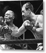 Rocky Marciano Landing A Punch Metal Print by Everett