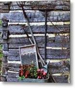 Tall Log Cabin And Garden Tools Metal Print by Linda Phelps