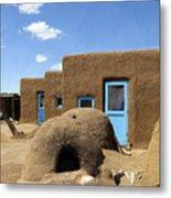 Tres Casitas Taos Pueblo Metal Print by Kurt Van Wagner