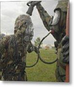 U.s. Air Force Soldier Decontaminates Metal Print by Stocktrek Images