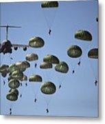 U.s. Army Paratroopers Jumping Metal Print by Stocktrek Images