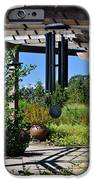Wind Chime In A Garden IPhone Case by Mandy Judson