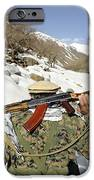 A Mujahadeen Guard Walks With U.s IPhone Case by Stocktrek Images