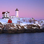 Nubble Light Under A Pastel Winter Sky Poster by Jeff Sinon