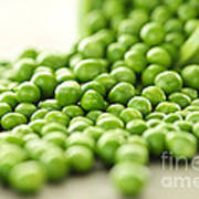 Spilled Bowl Of Green Peas Poster by Elena Elisseeva