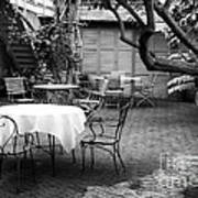 Courtyard Seating Poster by John Rizzuto