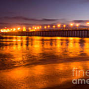 Huntington Beach Pier At Night Poster by Paul Velgos