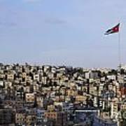 Jordanian Flag Flying Over The City Of Amman Jordan Poster by Robert Preston