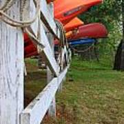 Kayaks On A Fence Poster by Michael Mooney