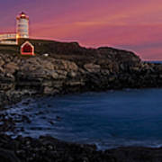 Nubble Lighthouse At Sunset Poster by Susan Candelario