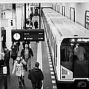 passengers on ubahn train platform as train leaves Friedrichstrasse u-bahn station Berlin Germany Poster by Joe Fox