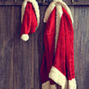 Santa's Hat And Coat Poster by Amanda And Christopher Elwell