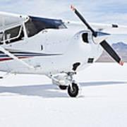 Cessna Aircraft On Bonneville Salt Flats Poster by Paul Edmondson