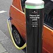 Recharging An Electric Car Poster by Martin Bond