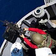 A Sailor Fires A .50-caliber Machine Poster by Stocktrek Images