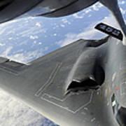 A B-2 Spirit Receives Fuel Poster by Stocktrek Images