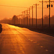 A Country Highway Fades Into The Sunset Poster by Joel Sartore