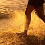 A Runner Splashing Through The Surf Poster by Phil Schermeister