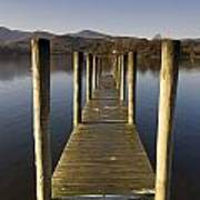 A Wooden Dock Going Into The Lake Poster by John Short