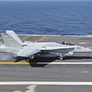 An Fa-18c Hornet Lands Aboard Uss Poster by Stocktrek Images