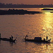 Boats Silhouetted On The Mekong River Poster by Steve Raymer